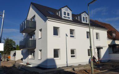 Neubau eines 3-Familienhauses mit Garagen in München